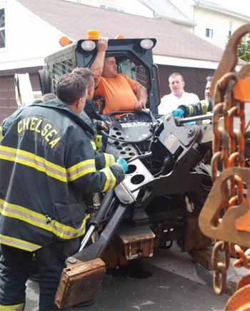 Chelsea Firefighters Rescue DPW Worker Trapped in Bobcat